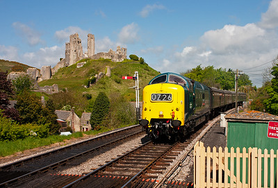 "Type 5 Deltic 55022 ""Royal Scots Grey"" runs into Corfe with the ruins of the castle in the background."