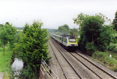 "A down working speeds through the village of Little Bedwyn with 43020 at the head of 1C12 0833 Paddington to Plymouth, ""The Mayflower""."