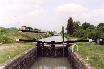 """I took this shot standing on the top gate of lock 60 with the bottom gate in the midground. 43129 approaches with 1C38 1333 Paddington to Penzance, the down """"Royal Duchy"""". Lock No 60 and the five previous westerly ones were only reopened to navigation in 1989."""