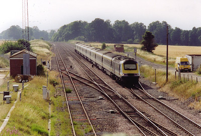 A final move now to Woodborough and the site of the station which closed on 18/4/1966.  The buildings and platforms are gone and up and down loops are here to allow the slow and heavy freight trains to be overtaken by the passenger workings.  The loops are empty as an unknown HST set speeds through with 1A70 1432 off Plymouth to Paddington, the up Mayflower.