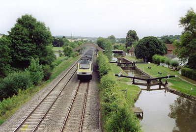 An unidentified down class 1 express train passes at speed climbing at 1 in 255 with 1C20 1003 Paddington to Penzance. The chamber of lock No 67 is being filled to allow a passing boat to lock down and head towards Reading.