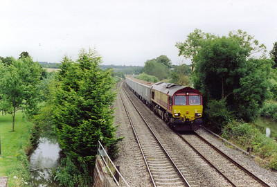 Shortly after the high speed set had passed, a westbound freight approached. 66222 powers a rake of empty JNA bogie boxes on an unknown working probably bound for Westbury or one of the two nearby quarries.