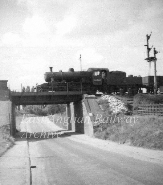 Class 2MT 46468 crossing what appears to be Sproughton Road Bridge in Ipswich although somewhat confused by the junction signal to the right.