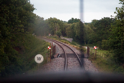 The rail over bridge takes the line over Grange Road with Creech Bottom user crossing ahead.