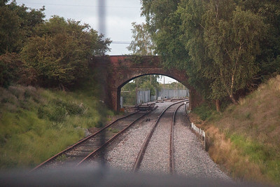 This is Furzebrook and the Furzebrook Road overbridge with the entrance to the former oil and gas sidings on the left.  The track on the left is the original main line and the track on the right was the runround loop and headshunt originally for the ball clay siding on the right.  The Railway changed the tracks as if ever a station is built here it will be to the right so the track is in place......if that makes sense? In 1979 the late Paddy Mulqueen, a member of the station staff at Wareham, invited me to go with him to Furzebrook in the cab of the loco going to collect the loaded oil tanks, so a cab ride to here was  not a new experience.
