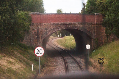 The line now passes below the main A351 Wareham to Corfe Castle road.  It was realigned in the 1990's and widened so the bridge is now twice the size.  Fortunately when the parapet was rebuilt the original top bricks and end stones were retained and put back in place.