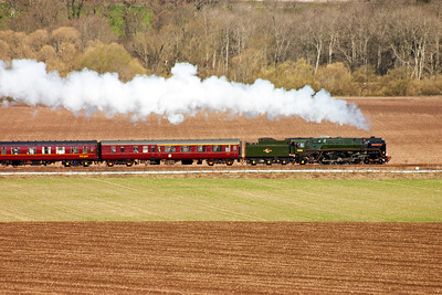 The attractive lines of the BR Standard class is shown as 70013 powers on to Perth and a water stop. 11/4/2010