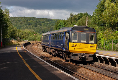 Moving to the east end of the Hope Valley and Grindleford station. Pacer 142033 makes its station stop with 2S10 0845 Manchester Piccadilly to Sheffield.