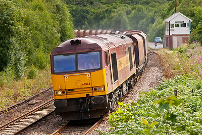 These stone trains are extremely heavy and the class 60 is almost required traction for them. 60094 has an easier job with the return empties though.