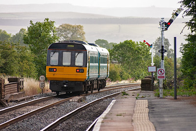 The set departs Edale station with Sheffield as the destination.  Both up and down boards are off.