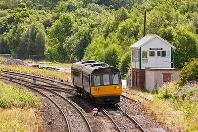 Moving to the west of Grindleford, to a small overbridge, and 142033 passes the 'box on a class 2 all stations stopper from Sheffield to Manchester Piccadilly, 1014 off 2S15.