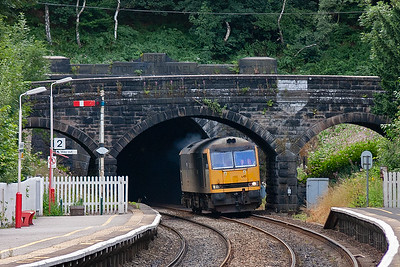 Transrail branded 60061 emerges from the blackness that is Totley Tunnel heading west light engine.