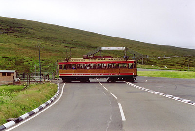 No 1 passes over the A18 at the famous level crossing at the Bungalow which is a feature of the TT motor cycle mountain race track .