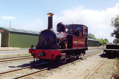 No 4 is running round its train at Port Erin. The green building in the background is the carriage shed
