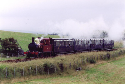 The day has dawned dull as No 11 works the 1010, first train off Douglas. It is seen near Keristal at the top of the 1 in 65 climb from Douglas.  23/7/1999