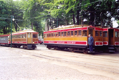 Down at Laxey it makes a connection but no junction with the Manx Electric Railway.  The motorman on SMR No 4 watches MER No 7 run in with the 1330 Douglas to Ramsey. The mountain tram will leave at 1400.