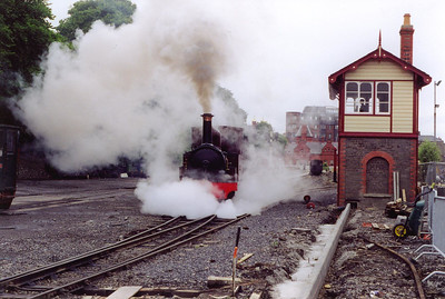 Amidst much steam and fuss No 15 gets away passing the recently moved signalbox.  18/7/1999