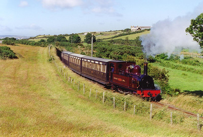The 1655 Douglas departure is the last down train of the day. No 4 climbs at 1 in 65 at Keristal. The wind has dropped and takes the exhaust to the left of the loco which is lit to perfection.  22/7/1999