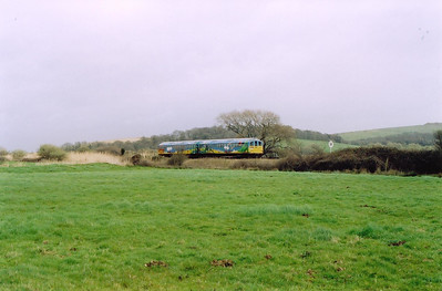 Out in the countryside of sorts and 002 passes by Morton with an up service, 1213 from Shanklin.