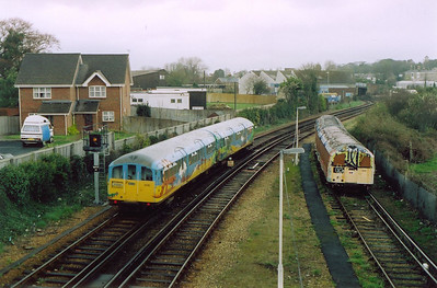 Unit 001 has been withdrawn and stored here for many many years and is heavily graffitied and wearing Network SouthEast livery. 006 passes by with the 1535 from Shanklin