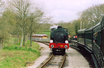 "The Isle of Wight Steam Railway extended their metals to Smallbrook Junction in 1991. Originally there was a junction here but no station. Now there is a station but no junction. 0-6-0ST Hunslet Austerity 198 runs round its train as unit 007 passes on the ""main line!"" with 1042 from Ryde Pier to Shanklin.  7/4/2004"