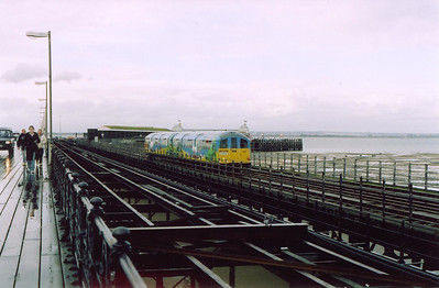 002 gets away from Pier Head, seen in the background, with yet another 20 minute run to Shanklin, 1745 off. People and cars have disembarked from one of the numerous ferries that call at the end of the pier.  5/4/2004
