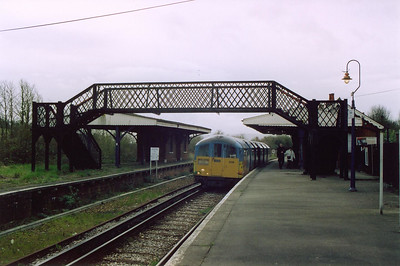 006 pauses at Brading, once a busy junction station for the short 2 3/4 mile branch to Bembridge which closed on 21/9/1953. Only the up platform is in use now. The train is the 1253 from Shanklin.
