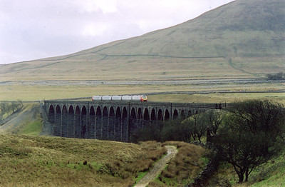 A north bound Virgin Cross Country working with 221136 crossing Ribblehead Viaduct. Its working is 1S56 0703 Birmingham New Street to Edinburgh. This and other Virgin trains were diverted via the S&C due to engineering works north of Preston on the WCML.
