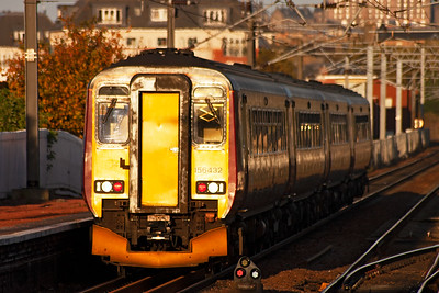 The strong lowering afternoon sun lights up the rear cab of 156432 as it departs the station after its booked stop. This is 2Y66, 1415 off Glasgow Central to Edinburgh.