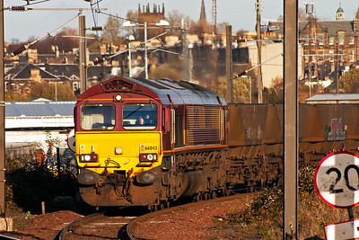 66043 eases off the Sub with a set of empty HAA coal hoppers bound for Mossend Yard. The train, 6S05, has come from Drax Power Station, 0805 off. The set will go for loading at a point as decided by the power generator.