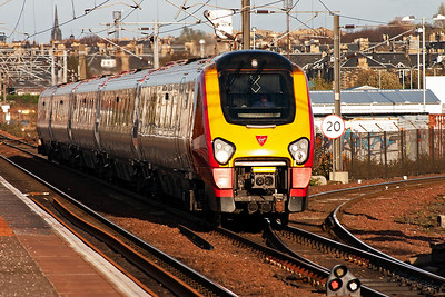 A west bound Voyager speeds away from the centre of Edinburgh and passes over the turnout onto the Edinburgh Suburban Line, known as The Sub. The working is 1M58 1452 from Edinburgh to Birmingham New Street.