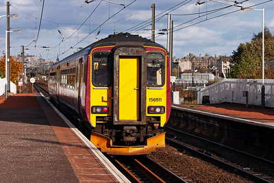 156511 departs Slateford station with a class 2 local service from Glasgow Central to Edinburgh Waverley.