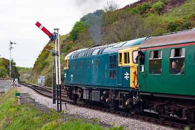 Swanage to Norden working 2N15 1350 from the seaside powers away from Corfe behind 33111.
