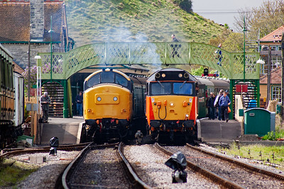 A contrast in front end designs form the English Electric stable. 37264 has a bonnet whilst 50135 does not. My brother Danny is walking over the footbridge on the right.