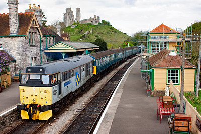 A deserted Corfe Castle station with 45133 departing for Norden with 3417 and 31271 with 2N06 1105 Harmans Cross to Norden.