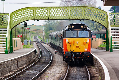 Loadhaul liveried 50135 passes below the footbridge with 2N09 1150 from Swanage to Norden. The timetable is around 43 minutes late but running to the rostered diagram.