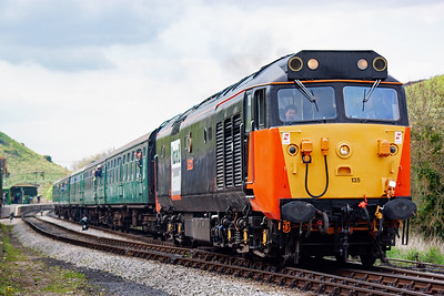The powerful type 4 100 mph originally rated 50135 powers up to take the train up the 1 in 80 over Corfe Common.