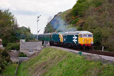 The class 56 is back on its rostered diagram and here it smokes into Corfe Castle with 33111 translating the brake with 2S15 1430 Norden to Swanage.