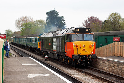 """""""He ain't heavy, he's my brother"""". Elder brother Danny watches 50135 run in with 3417 and 37264 with a shuttle to Norden from Harmans Cross."""