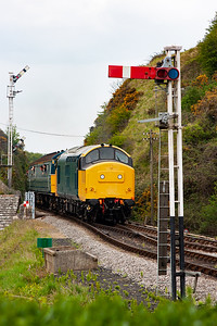 The train is framed between the down home double acting signal and the short up starter.
