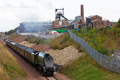 The noise from the Gresley pacific puts a flock of birds up into the air as the train passes by.  The close proximity of the main line here was the reason why the colliery was sunk here.