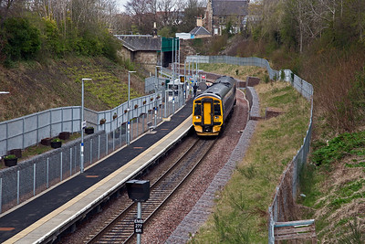 Gorebridge station viewed from the bridge to the south of the single platform.  158739 comes to a stand with 2T74 1024 Edinburgh to Tweedbank.  There are several people on the platform but they are waiting for the Edinburgh train.  14/4/2017