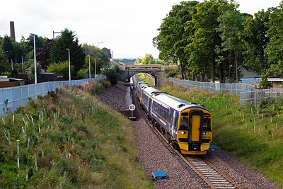 Moving south slightly and this is Newtongrange.  158735 with 158729 depart the relocated and newly built Newtongrange station just beyond the bridge with 2T67 0928 from Tweedbank to Edinburgh.  The original station was located right where the units are.