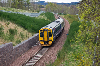This is the view from the foot bridge just visible in the previous photo.  158736 drops downgrade near Arniston with 2T69 0959 off Tweedbank for Edinburgh.