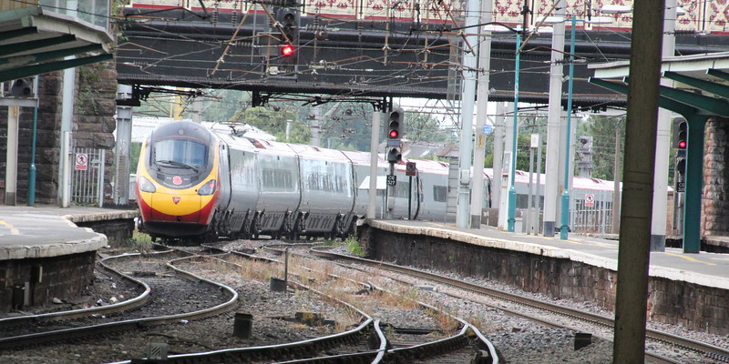 Pendolino 390 103 on 1S52 (1030 EUS to GLC) leaving Carlisle. Carlisle 25 July 2015