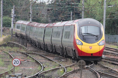 Pendolino 390 046 on 1M13 (1240 GLC to EUS) leaving Carlisle Carlisle 25 July 2015