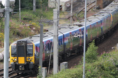 350 409 and another Class 350 on 1M99 (1417 EDB to MIA) passing Caldew Junction. Carlisle 25 July 2015