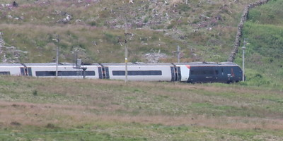 Pendolino 390001 working 1M12 (1133 Glasgow to London) at Shap Wells 9 July 2021
