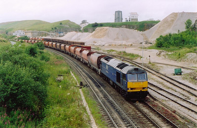 Another arrival at Peak Forest is Mainline blue 60044 with 6H60 0800 Hope Street to Peak Forest empty RMC JGA hoppers.