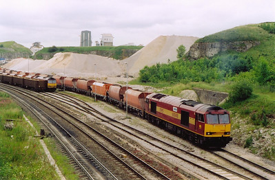 60048 slowly propells its rake of 24 JGA hoppers into the RMC quarry at Peak Forest.